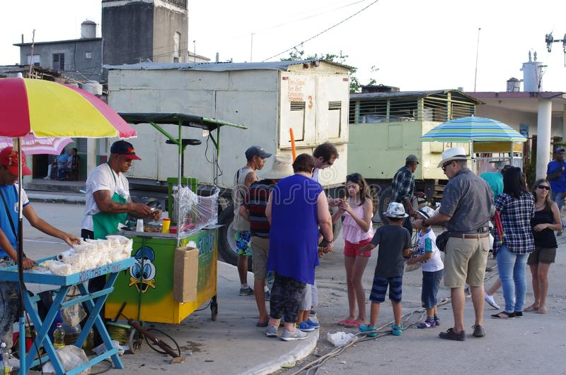 Lineup for a fast food and drinks in small Cuban town during festival stock photos