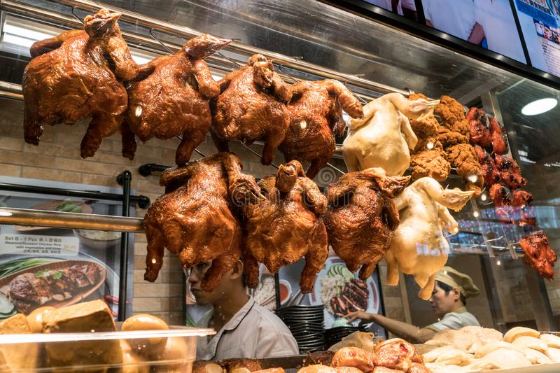 Street food vendors selling traditional roasted duck meal in Singapore royalty free stock photo
