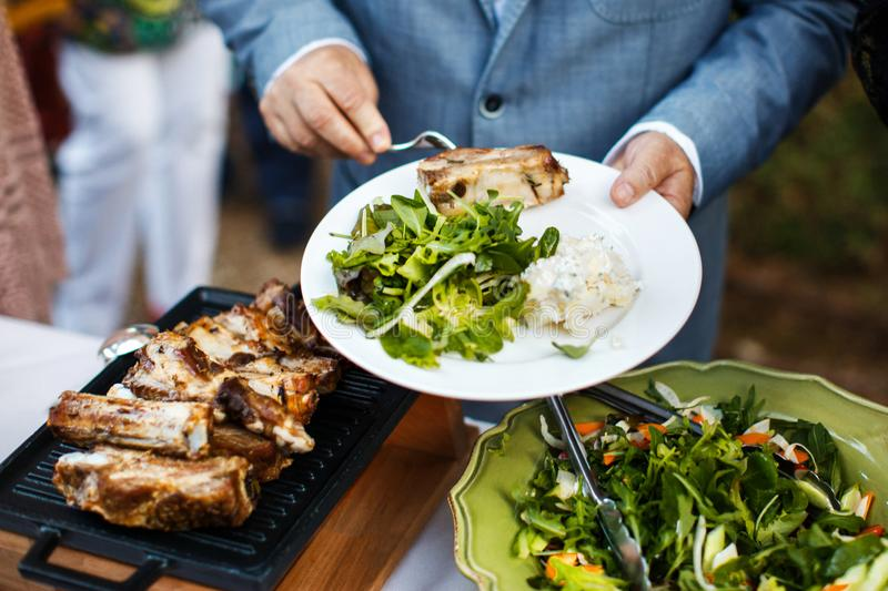 Street food at the wedding or another catered event dinner royalty free stock photos