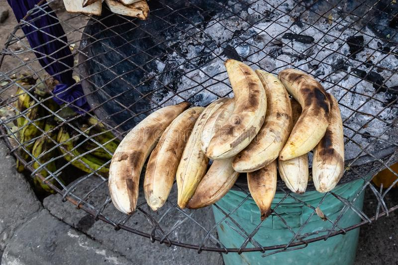 Street foods in Lagos Nigeria; Bole otherwise known as roasted plantain. Street foods in Lagos Nigeria; A roadside charcoal grill with roasted plantain otherwise royalty free stock photography