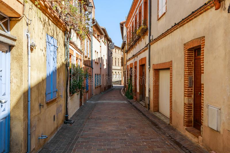 Street in French ancient town Toulouse. Toulouse is the capital of Haute Garonne department and Occitanie region, France, South. Europe. Famous tourist stock image