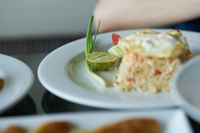 Street fried rice with fried egg on top with lemon seasoning stock photography