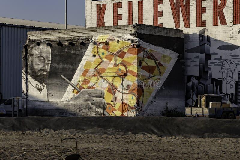 Street graffiti art Man drawing in Rotterdam royalty free stock photo