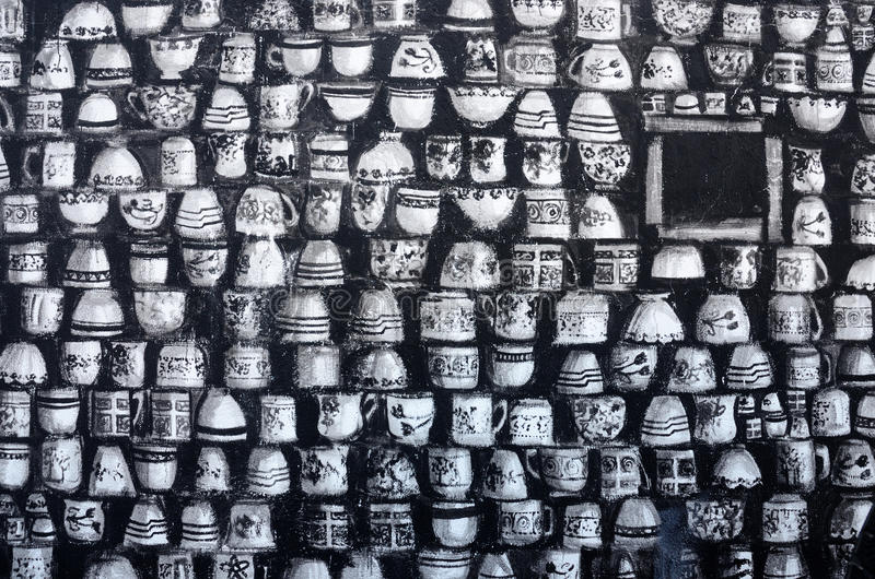 Street graffiti art murals depicting black-and-white cups in old center of Paphos,Cyprus,Europe stock images