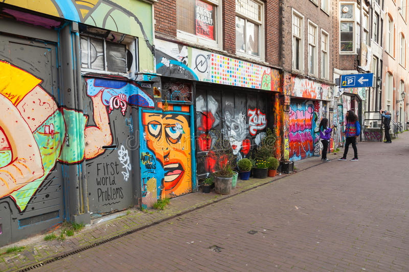 Street with graffiti on building facades in Amsterdam stock photo