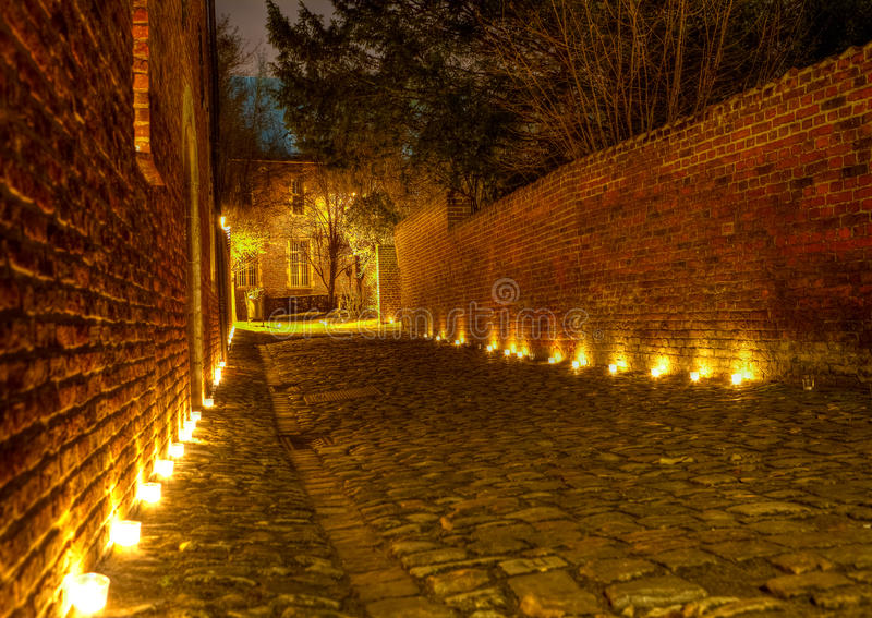 Street in the Great Beguinage, Leuven, Belgium at. Street with cobble pavement at the Great Beguinage (Groot Begijnhof) of Leuven, Belgium, at night lighted with royalty free stock images