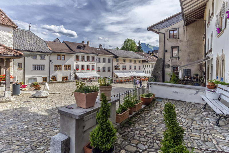 Street in Gruyeres village, Fribourg, Switzerland. Street in Gruyeres village by day, Fribourg, Switzerland royalty free stock photos