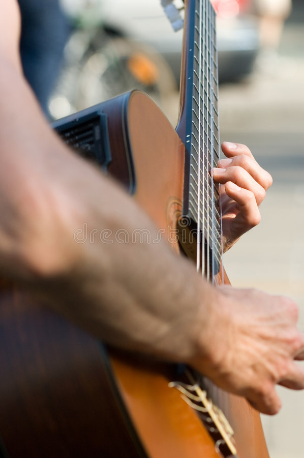 Street guitarist stock photography