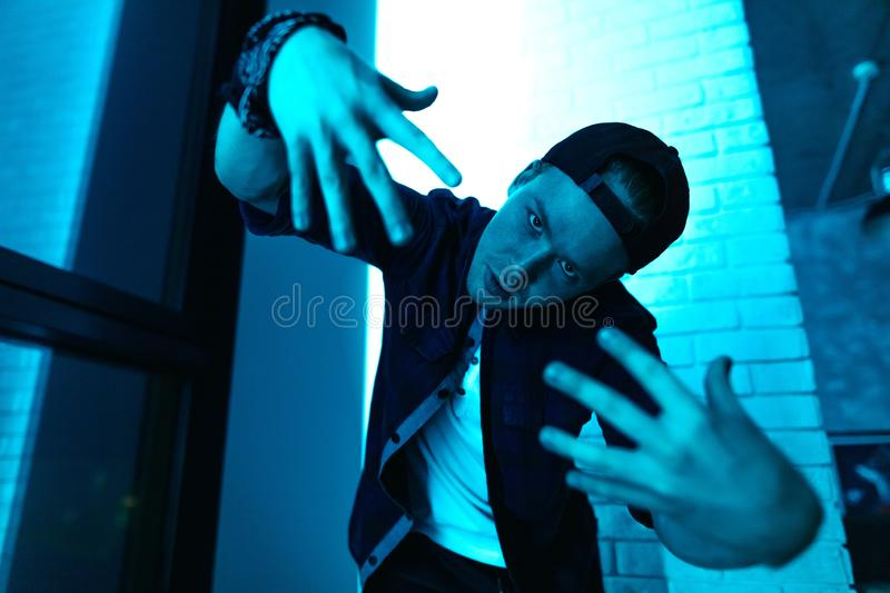 Street guy is having fun in front of the camera royalty free stock image