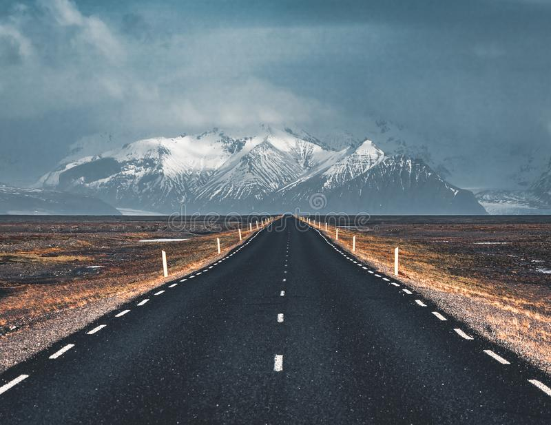 Street Highway Ring road No.1 in Iceland, with view towards mountain. Southern side if the country. Photo taken in Iceland royalty free stock images