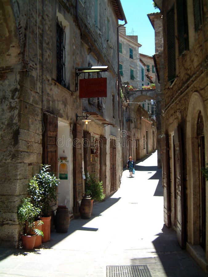 Street in hilltown. Street in old Tuscan Hilltown, unspoilt by traffic and modernisation royalty free stock photography