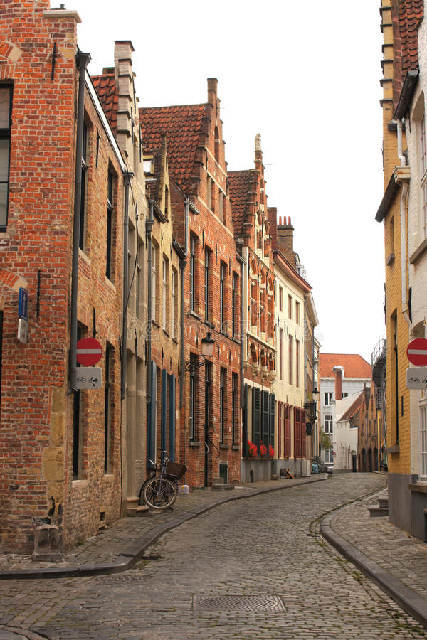 Street with historic medieval buildings, Bruges, Belgium royalty free stock photo