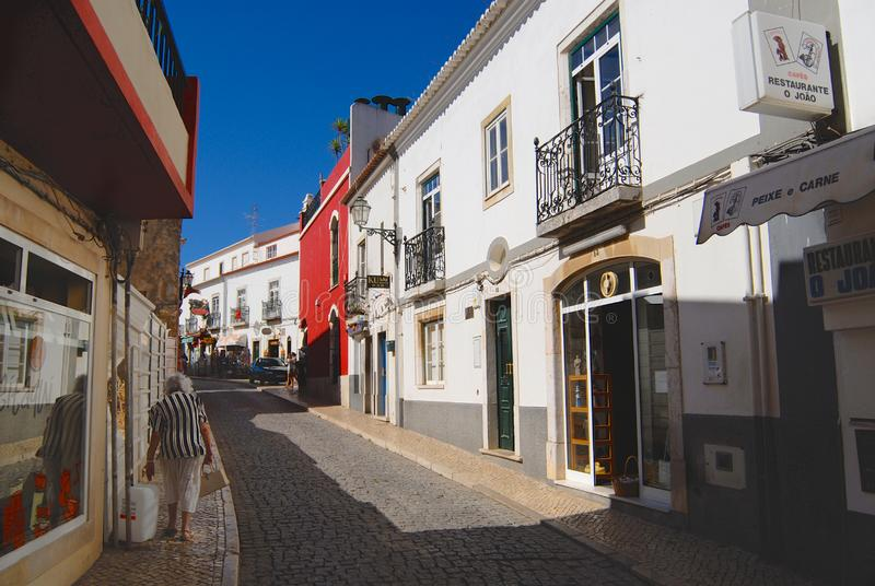 Street with historical buildings in downtown Lagos, Portugal. Lagos is a touristic destination town in Algarve, Portugal. royalty free stock photography