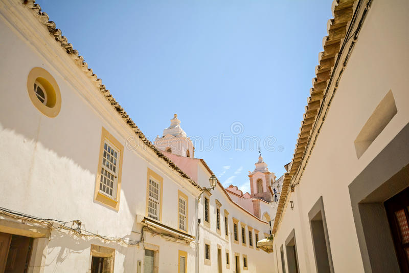 Street with historical buildings in the old town of Lagos, Algarve Portugal Europe. Street with historical buildings in the old town of Lagos, Algarve Portugal stock photos
