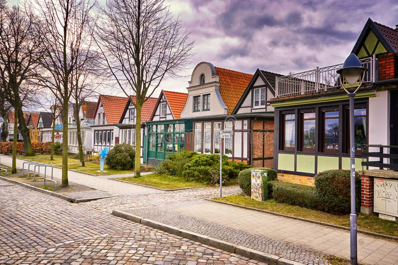 A street with houses in the old town in Warnemünde at the old harbor. Rostock, Germany stock photo