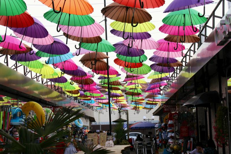 Street installation with colorful, beautiful umbrellas floating in the air against the sky. stock image