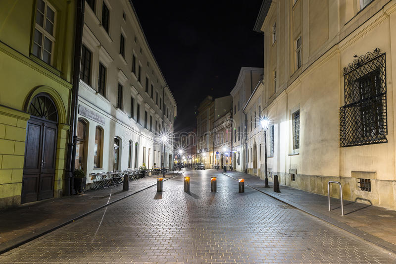 Street in Krakow by night stock images