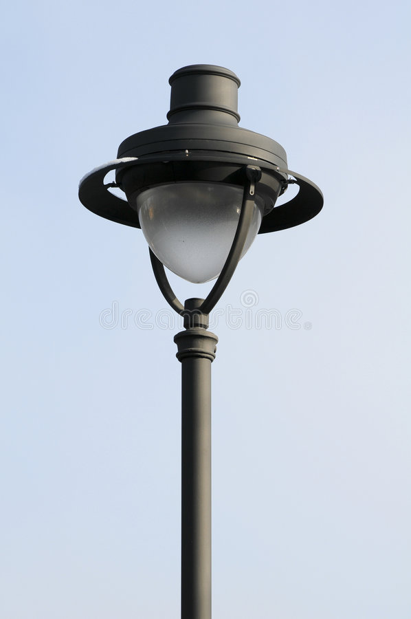 Street lamp. Old street lamp against blue sky stock photography
