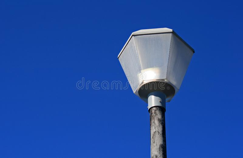 STREET LAMP AGAINST THE BLUE SKY IN DAYTIME stock images
