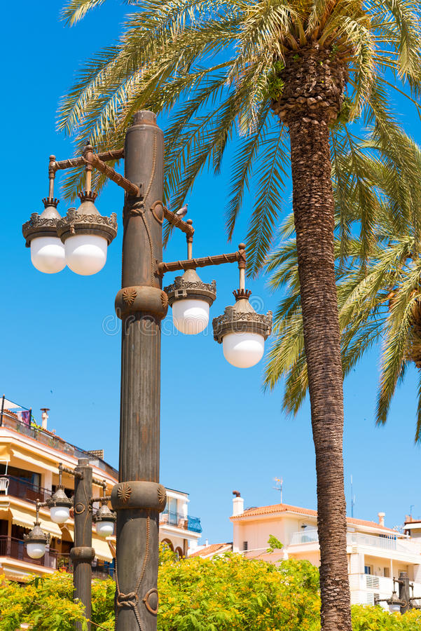 Street lamp against the blue sky, in Sitges, Barcelona, Catalunya, Spain. Copy space for text. Isolated on blue background. royalty free stock image