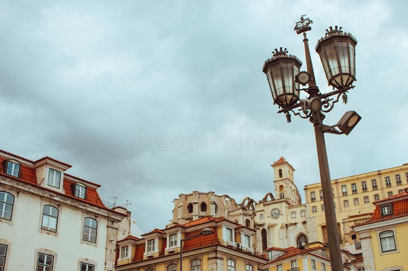 Street lamp against cloudy sky and historical center of Lisbon, Portugal. Lisbon landmark. Ancient architecture in Europe. Travel concept. Traditional medieval stock image
