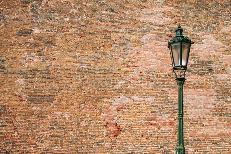 Street lamp on brick wall background. Street lamp on brick wall background royalty free stock photography