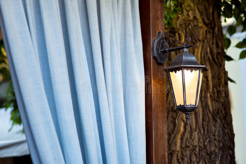 A street lamp on a brown pillar. stock images