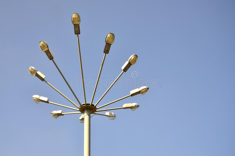 A street lamp consisting of a high pillar and a number of plafonds for light sources. Unusual view of street lighting in Ukrain. E royalty free stock photo