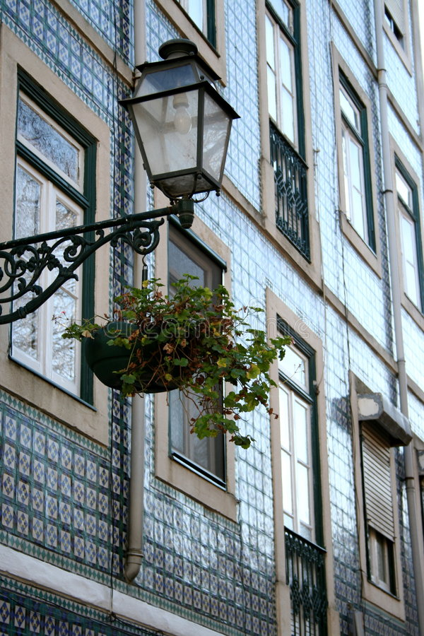 Street lamp with flowers stock image
