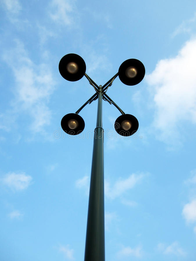 Download Street Lamp With Four Hands Stock Image - Image: 24308643