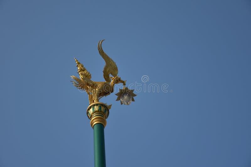Street lamp with golden bird stock photos