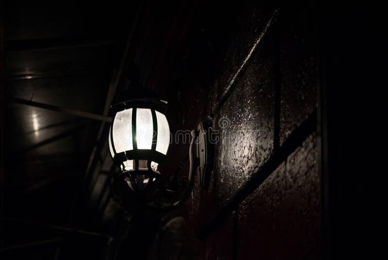 Street lamp illuminates in the dark stock image