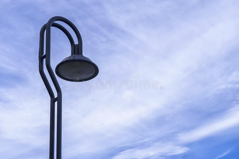 Street lamp or light pole with blue sky background.  stock image