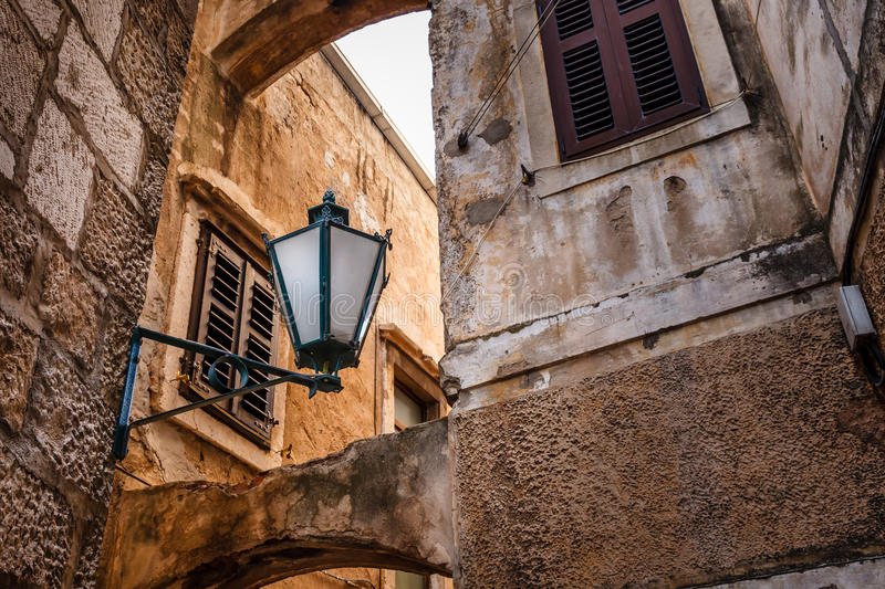Street Lamp in the Narrow Street of Omis royalty free stock photo