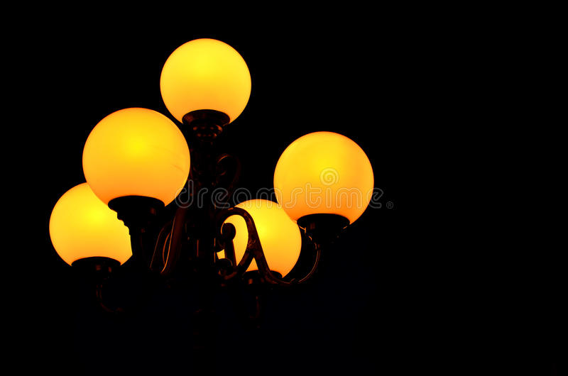 Street lamp in the night dark. Street lamp is shining with warm balls in the black darkness of the night stock photos