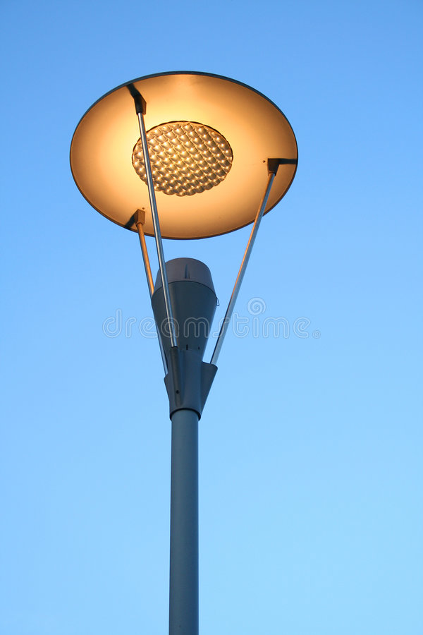 Street lamp post. A street lamp also known as a lamp post, used to light up the path royalty free stock image