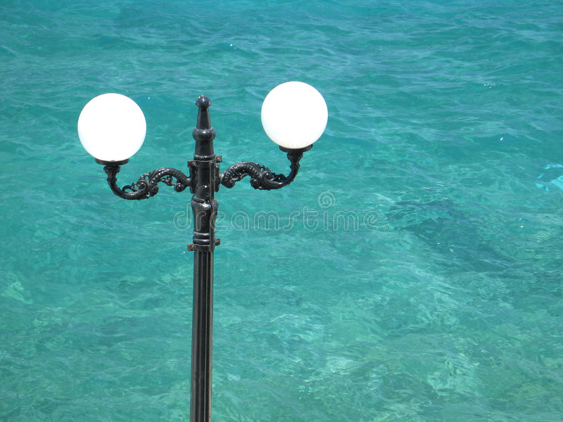 Download Street Lamp and the Sea stock photo. Image of coast, contrast - 156994