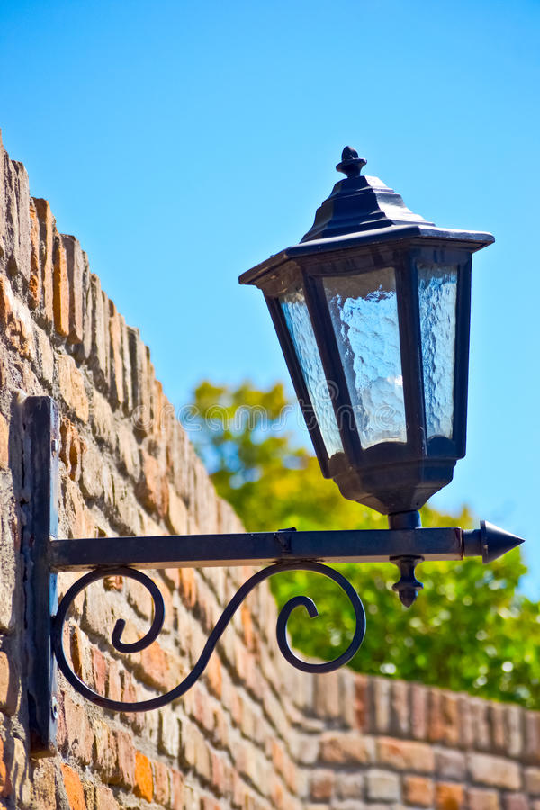 Download Street Lamp On A Textured Brick Wall Autumn Stock Photo - Image: 26590316