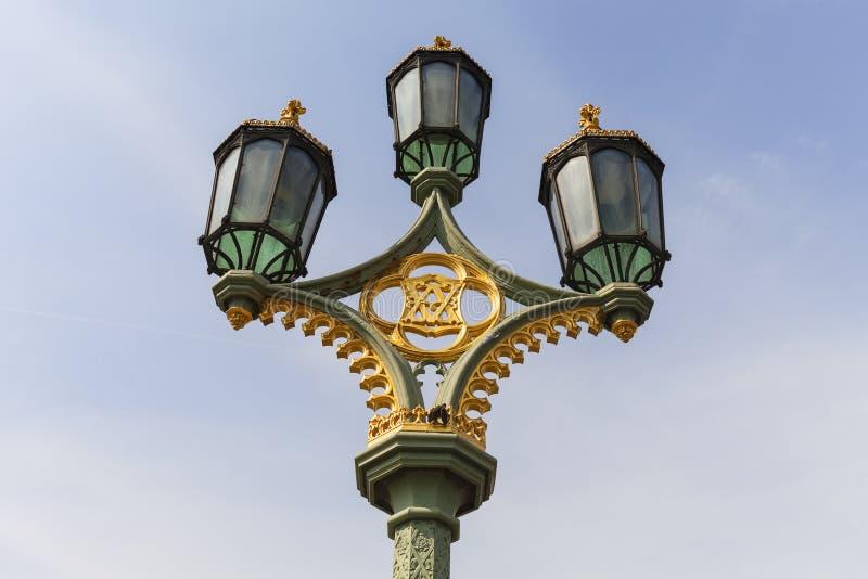 Street lamp on Westminster Bridge on the background of blue sky, London, United Kingdom. stock image