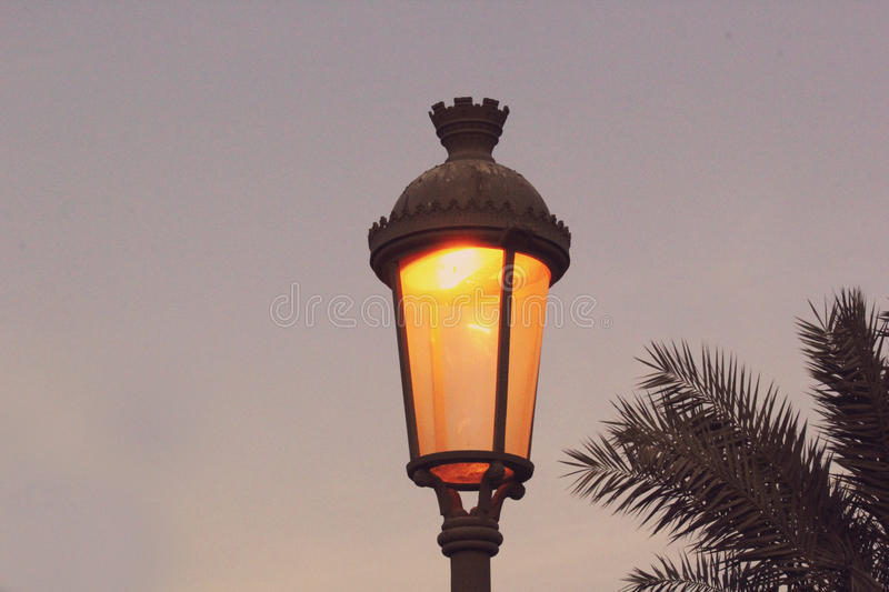 Street lamp in working mode in the winter night. A blue sky background looks good. Beautiful shot picture royalty free stock photos