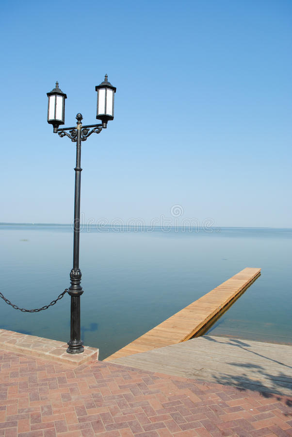 Download Street lamppost and lake stock image. Image of shore - 20977143