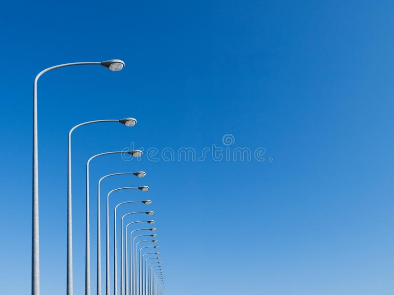 Street lamps aligned stock photos