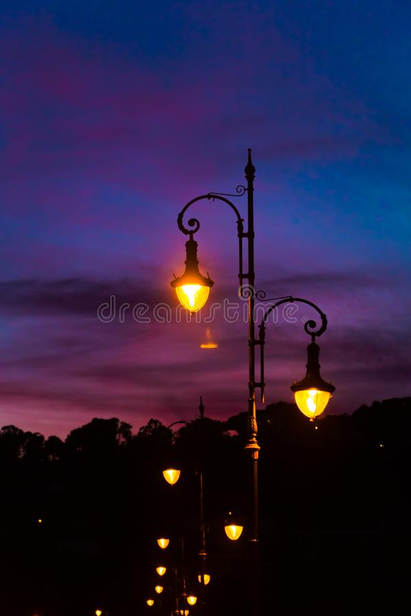 Street lamps with beautiful and colorful sunset sky royalty free stock images