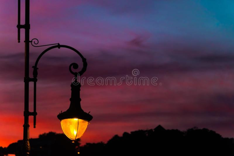 Street lamps with beautiful and colorful sunset sky royalty free stock photo