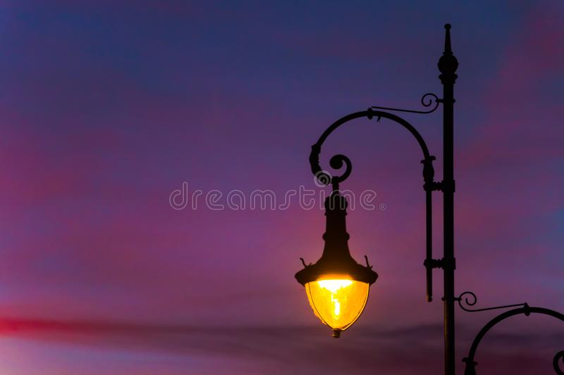 Street lamps with beautiful and colorful sunset sky royalty free stock image