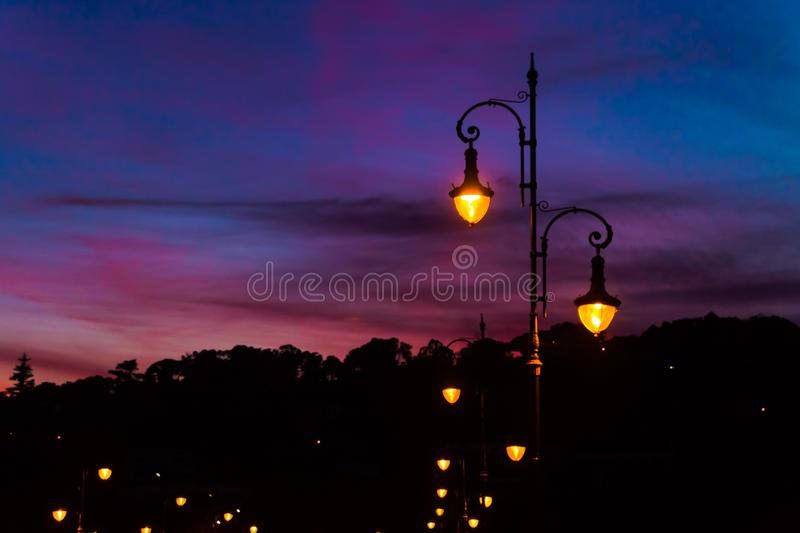 Street lamps with beautiful and colorful sunset sky stock images