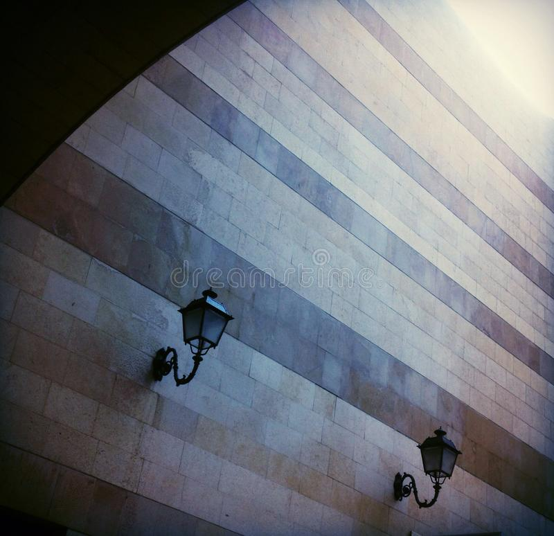 Street lamps and designed wall. royalty free stock photography