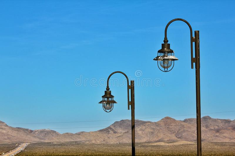 Street lamps mountain background. With blue sky on a sunny day stock photo