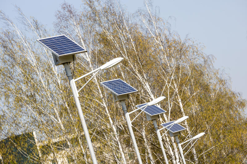 Street lamps with solar panels stock photography
