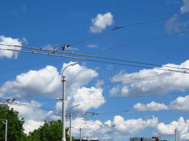 Street lamps and trolleybus electricity power grid supply. City town urban landscape. stock images